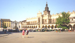 Two Norwegian girls crossing the huge market place in Krakow - a wonderful city, but very polluted.