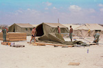 We put up tents made for Norwegian winters in the desert sand of Somalia. The first few months we stayed at the airport - right next to the runway...