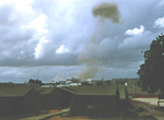 We lived in tents at the compound too, at least for the first few months. Later we moved into a safer concrete bulding. The smoke is from a controlled detonation of ammonition and explosives.