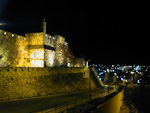 The wall of the Old City by night.