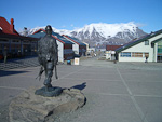 In the center of Longyearbyen there is a statue of a coal miner. The mountains on the island group contain large quantities of black coal, and exploration of this has been the foundation of the settlements here. Now there is also some tourist industry here, and several countries are doing research here.