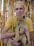 (English) By making a donation to establishing a wildlife reserve in Mexico, I could hold a baby lion in my lap.