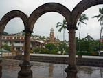 (English) The church seen through the arches of Los Archos amphitheater.