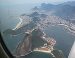 Rio de Janeiro, one of the world's most densly populated areas, is an impressive sight from an airplane. The picture shows the southern parts of the city. To the left is the 4.5 kilometer long Copacabana beach. In the foreground is Pão de Açucar (Sugar Loaf), a 396 meters tall mountain.