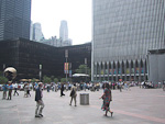 A concert is held at the plaza in the middle of the World Trade Center.
