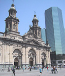 The Cathedral at Plaza de Armas stands next so some modern glass-covered buldings, showing the blend of modern and historic buildings in Santiago. At night, the modern buildings on this picture are completely dark, while the Cathedral is bathing in light.