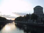 The Four Courts by Liffey river at sunset.