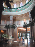 The lobby of the Palace of the Lost City. Only residents of the hotel are alowed inside the premises. The floor shines with 300000 fragments of polished marble and granite, and 25 meters above it, the ceiling is decorated by frescoes.