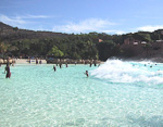 The Roaring Lagoon in the Valley of Waves. A wave-machine produces waves of varying size. At fixed intervalls there are extra large waves, like on this picture. At those times, the lagoon is filled with children.