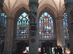There are large and impressive stained glasses in the cathedral.