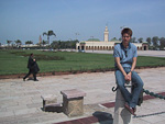Chris outside the Royal Palace, with the Ahl al-Fas Mosque in the background.