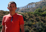 In front of the famous Hollywood sign in Griffith Park.