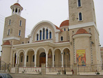 The largest church in Pyla, with banners with Greek letters.