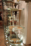 The World's tallest and largest volume chocolate fountain at the Bellagio. 6 pumps circulate nearly 2 tons of chocolate at a temperature of 50 degrees C (120 F).