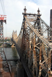 The Queensboro Bridge crosses the East River, via Roosevelt Island.