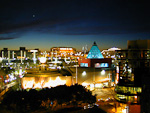 Darling Harbour at night. The building with the blue glass pyramid on top of it is Sega World.