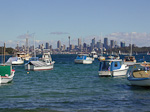 Watsons Bay with the Sydney Skyline in the background.