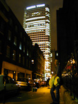 André in a dark street in Soho. The tall building is the Centre Point.