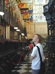 André looking at all the banners inthe eastern wing of Westminster Abbey.