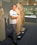André next to some old Roman statues.