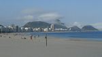 Pão de Açúcar covered by clouds, seen from Copacabana beach.