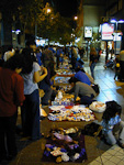 At night, the pedestrian streets are full of people, and people are selling all kind of things. The prices are very low. Not only at this market, but also in general in Santiago.
