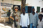 US Msgt Glyn Perry mingling with the locals during a security mission.