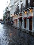 A cobblestoned street after a rain shower.