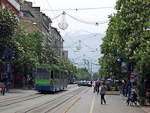 Vitosha street is the main shopping street in Sofia. The mountain Vitosha can be seen in the distance.