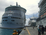 Freedom of the Seas docked next to Celebrity Solstice and Carnival Valor.
