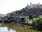 On top of the highest hill in Toledo is the stone fortification Alcazar. It was first built by the Romans during the third century, and later used by Muslim and Christian rulers. Below, the river Tagus runs along the city's western, southern and eastern walls.